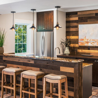 Example of a small transitional single-wall porcelain floor and multicolored floor seated home bar design in DC Metro with an undermount sink, shaker cabinets, dark wood cabinets, granite countertops, brown backsplash and wood backsplash