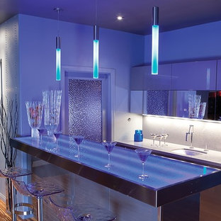 This is an example of a medium sized modern single-wall breakfast bar in San Diego with a submerged sink, flat-panel cabinets, white cabinets, granite worktops and medium hardwood flooring.