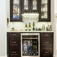 Contemporary Home Bar by Zelmar Kitchen Designs & More, LLC