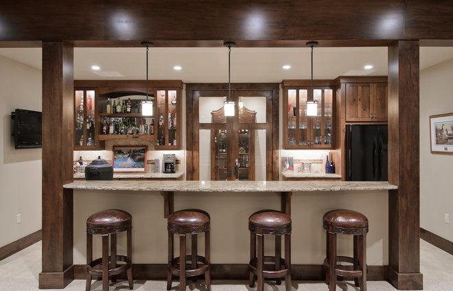 Traditional Home Bar by Aneka Interiors Inc.