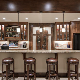 Example of a classic galley seated home bar design in Denver with glass-front cabinets, granite countertops, dark wood cabinets and beige backsplash