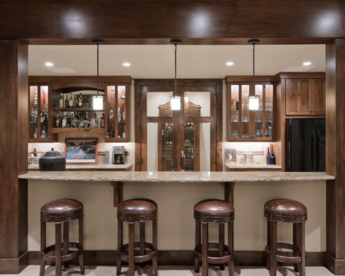 Bar Design Ideas For Home traditional l shaped basement bar with high countertop installed stained maple wood with black Home Bar Design Ideas Remodels Photos