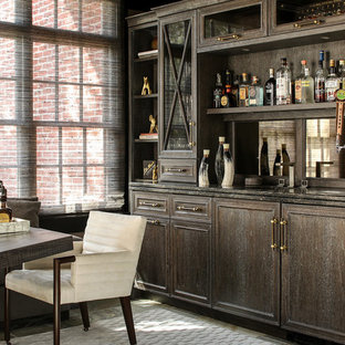 Photo of a medium sized traditional single-wall wet bar in New York with freestanding cabinets, dark wood cabinets, marble worktops, mirror splashback, carpet and grey floors.