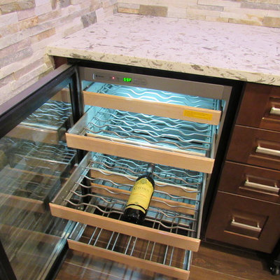 Example of a large trendy galley porcelain tile wet bar design in New York with an undermount sink, shaker cabinets, dark wood cabinets, granite countertops, multicolored backsplash and stone tile backsplash