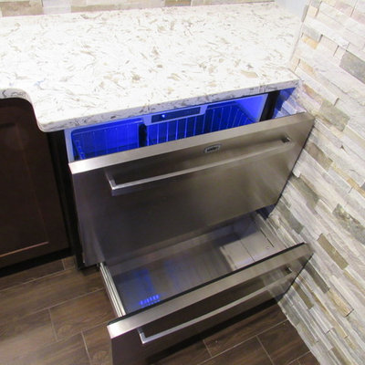 Large trendy galley porcelain tile wet bar photo in New York with an undermount sink, shaker cabinets, dark wood cabinets, granite countertops, multicolored backsplash and stone tile backsplash