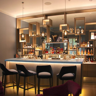 Large modern single-wall bar cart in London with a built-in sink, open cabinets, light wood cabinets, onyx worktops, multi-coloured splashback, mirror splashback, light hardwood flooring, grey floors and white worktops.