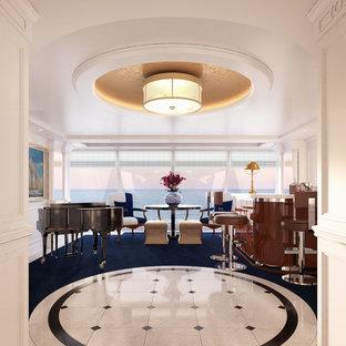 マイアミの広いトランジショナルスタイルのおしゃれな着席型バー (コの字型、フラットパネル扉のキャビネット、濃色木目調キャビネット、クオーツストーンカウンター、カーペット敷き、青い床、白いキッチンカウンター) の写真