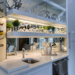 Design ideas for a small contemporary single-wall wet bar in Toronto with a submerged sink, shaker cabinets, white cabinets, engineered stone countertops and mirror splashback.