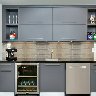 Small contemporary single-wall wet bar in Toronto with a submerged sink, flat-panel cabinets, grey cabinets, engineered stone countertops, grey splashback, metal splashback and medium hardwood flooring.