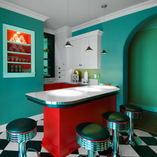 Small elegant l-shaped linoleum floor and multicolored floor wet bar photo in Milwaukee with a drop-in sink, shaker cabinets, white cabinets, solid surface countertops, white backsplash and white countertops