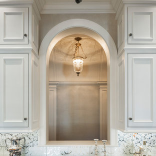 Photo of an expansive classic single-wall wet bar in Philadelphia with a submerged sink, beaded cabinets, white cabinets, marble worktops, white splashback and dark hardwood flooring.