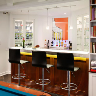 This is an example of a small midcentury single-wall breakfast bar in Chicago with open cabinets, white cabinets, glass worktops, dark hardwood flooring and brown floors.