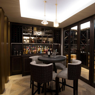 Inspiration for a contemporary single-wall home bar in Cheshire with black splashback, medium hardwood flooring and brown floors.