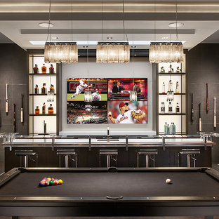 Inspiration for a contemporary dark wood floor home bar remodel in Phoenix with white countertops
