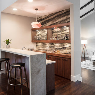 Inspiration for a medium sized midcentury u-shaped wet bar in Miami with a submerged sink, glass-front cabinets, brown cabinets, marble worktops, brown splashback, marble splashback, dark hardwood flooring, brown floors and beige worktops.