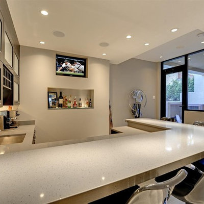 Inspiration for a large contemporary u-shaped home bar remodel in Minneapolis with an undermount sink, glass-front cabinets, gray cabinets and beige countertops