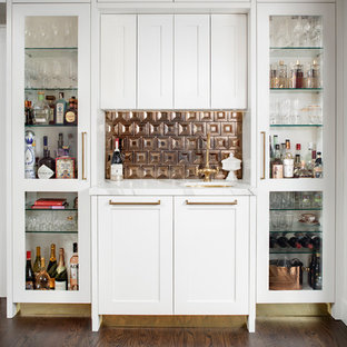 Small classic single-wall wet bar in San Diego with shaker cabinets, white cabinets, marble worktops, brown floors, a submerged sink, brown splashback, metal splashback, dark hardwood flooring and white worktops.