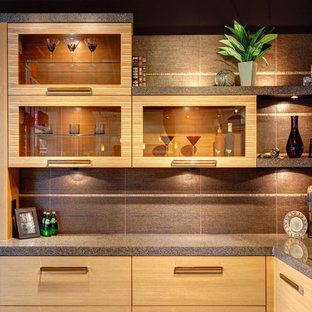 Example of a mid-sized minimalist l-shaped wet bar design in Chicago with an undermount sink, light wood cabinets, porcelain backsplash, flat-panel cabinets, terrazzo countertops and gray backsplash