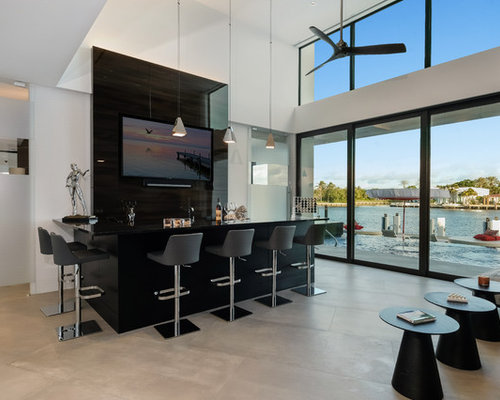 Example Of A Trendy L Shaped Gray Floor Seated Home Bar Design In Miami With
