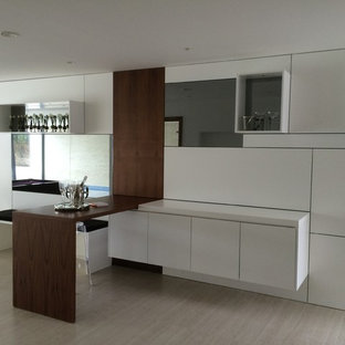 Design ideas for a medium sized contemporary single-wall wet bar in Dorset with flat-panel cabinets, white cabinets, wood worktops, white splashback, glass sheet splashback, ceramic flooring and brown worktops.
