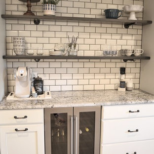 Inspiration for a small country single-wall vinyl floor home bar remodel in Detroit with no sink, shaker cabinets, beige cabinets, granite countertops, beige backsplash and subway tile backsplash
