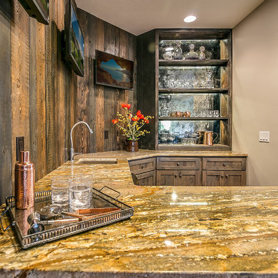 Example of a mid-sized mountain style u-shaped seated home bar design in Other with an undermount sink, open cabinets, dark wood cabinets, granite countertops, brown backsplash, wood backsplash and brown countertops