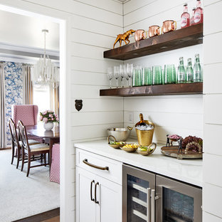 Inspiration for a small farmhouse single-wall home bar in DC Metro with no sink, shaker cabinets, white cabinets, dark hardwood flooring, brown floors and white worktops.