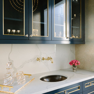 Inspiration for a medium sized traditional single-wall wet bar in Chicago with a submerged sink, blue cabinets, white splashback, white worktops, glass-front cabinets, marble worktops and marble splashback.