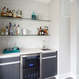 This is an example of a small modern single-wall wet bar in Boise with a submerged sink, flat-panel cabinets, grey cabinets, marble worktops, white splashback, ceramic splashback and bamboo flooring.