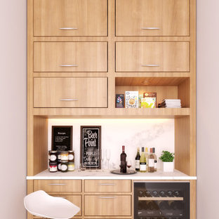 Design ideas for a medium sized modern single-wall wet bar in Baltimore with no sink, flat-panel cabinets, light wood cabinets, marble worktops, white splashback, marble splashback, light hardwood flooring, brown floors and white worktops.