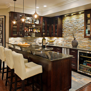 Photo of a large transitional u-shaped seated home bar in New York with dark hardwood floors, glass-front cabinets, dark wood cabinets, multi-coloured splashback, stone tile splashback, grey benchtop and granite benchtops.