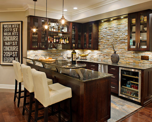 Example Of A Large Classic U Shaped Dark Wood Floor Seated Home Bar Design  In