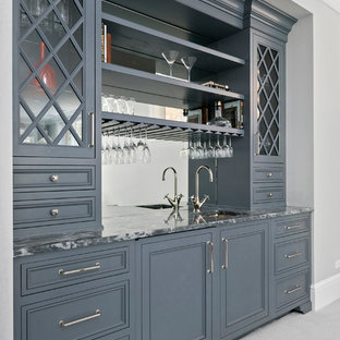 Design ideas for a small classic single-wall wet bar in Chicago with a submerged sink, recessed-panel cabinets, grey cabinets, marble worktops, grey splashback, mirror splashback and carpet.