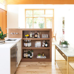 Inspiration for a 1960s light wood floor and beige floor wet bar remodel in Phoenix with an undermount sink, open cabinets, medium tone wood cabinets and white countertops