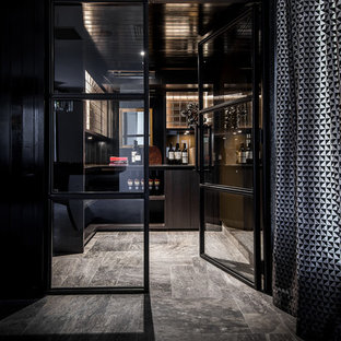Moody mirror & timber panelled wine cellar with steel doors