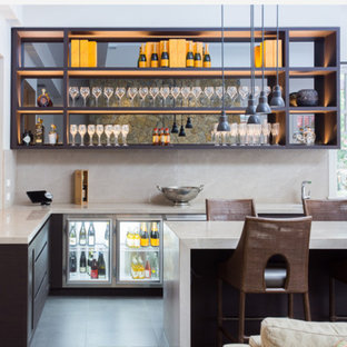 Example of a trendy l-shaped gray floor seated home bar design in Minneapolis with an undermount sink, open cabinets, black cabinets and beige backsplash