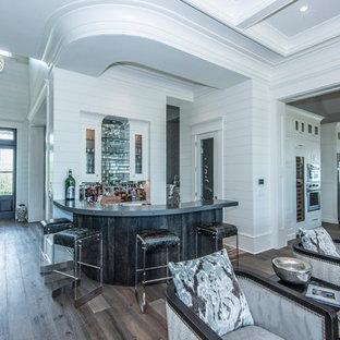 Example of a mid-sized eclectic l-shaped medium tone wood floor and gray floor seated home bar design in Charleston with an undermount sink, furniture-like cabinets, gray cabinets, zinc countertops, multicolored backsplash and mirror backsplash