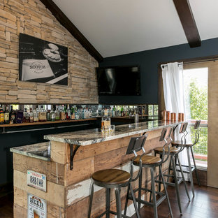 Inspiration for a rustic medium tone wood floor seated home bar remodel in Austin