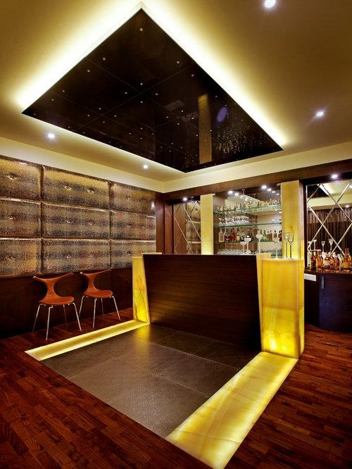 Angolo bar moderno con top in legno foto idee arredamento for Angolo bar moderno