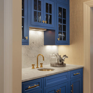 Inspiration for a medium sized traditional galley wet bar in New York with a submerged sink, recessed-panel cabinets, blue cabinets, marble worktops, white splashback, marble splashback, medium hardwood flooring and brown floors.