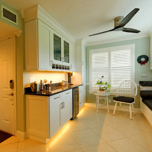 Photo of a small traditional single-wall wet bar in Tampa with white cabinets, granite worktops and shaker cabinets.