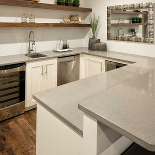 Photo of a medium sized traditional u-shaped breakfast bar in Raleigh with a submerged sink, shaker cabinets, white cabinets, engineered stone countertops, dark hardwood flooring, brown floors and grey worktops.