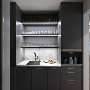 This is an example of a small modern single-wall wet bar in Los Angeles with a submerged sink, flat-panel cabinets, grey cabinets, marble worktops, grey splashback, marble splashback, dark hardwood flooring, brown floors and grey worktops.