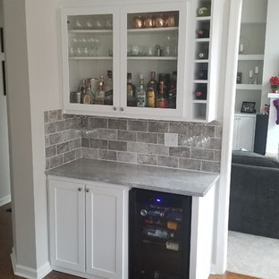 Photo of a small contemporary single-wall bar cart in Atlanta with shaker cabinets, white cabinets, marble worktops, grey splashback, metro tiled splashback, medium hardwood flooring, brown floors and grey worktops.
