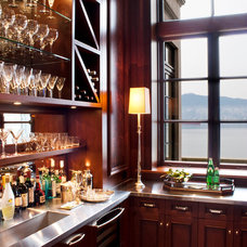 Traditional Home Bar by Kindred Construction Ltd.