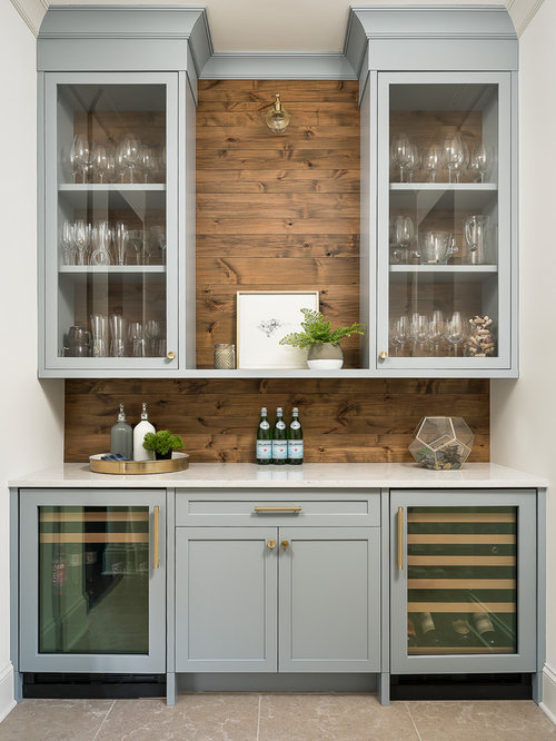 Example Of A Large Transitional Home Bar Design In Chicago