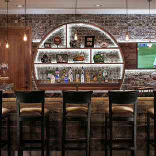 Example of a large urban single-wall concrete floor and gray floor seated home bar design in Omaha with open cabinets, brick backsplash, medium tone wood cabinets and granite countertops