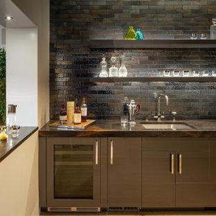 Photo of a large contemporary l-shaped wet bar in San Francisco with a submerged sink, flat-panel cabinets, brown cabinets, marble worktops, black splashback, ceramic splashback, light hardwood flooring, beige floors and brown worktops.