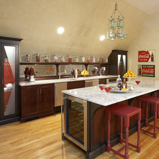 Example of a large eclectic galley medium tone wood floor seated home bar design in Chicago with an undermount sink, shaker cabinets, dark wood cabinets, marble countertops and mirror backsplash