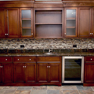 This is an example of a medium sized classic single-wall wet bar in Chicago with a submerged sink, recessed-panel cabinets, dark wood cabinets, marble worktops, multi-coloured splashback, matchstick tiled splashback and slate flooring.